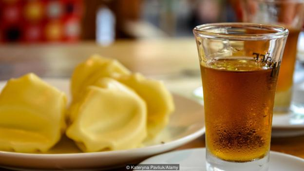 Traditional Georgian pomace brandy called chacha, also known as grape vodka or Georgian grappa and traditional food Khinkali served at cafe
